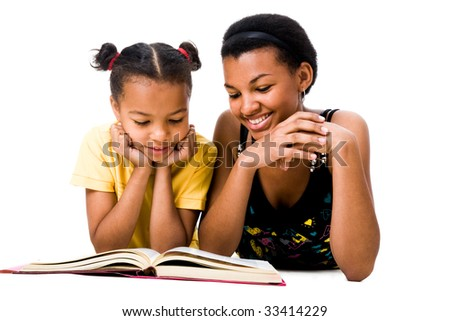 Image of woman and girl reading the book together - stock photo