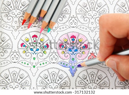 image of woman coloring, adult coloring book trend, for stress relief.  top view - stock photo