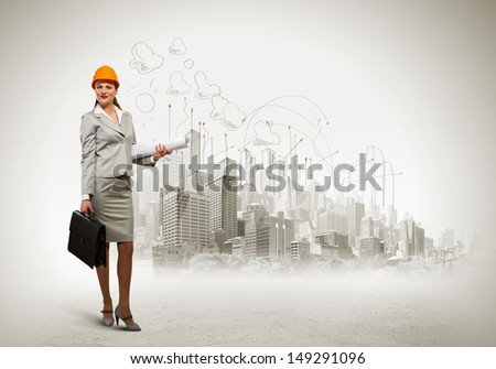 Image of woman engineer in helmet with drafts. Construction concept - stock photo