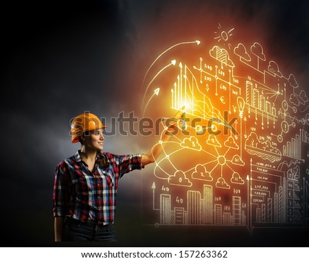 Image of woman in hardhat pushing icon of media screen - stock photo