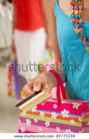 Image of woman?s hand giving plastic card in the mall - stock photo