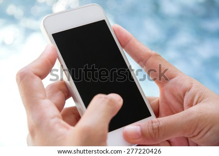 image of  Woman Using a Smart Phone - stock photo