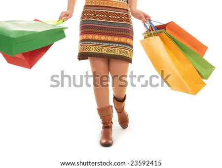 Image of woman walking back from shop over white background - stock photo