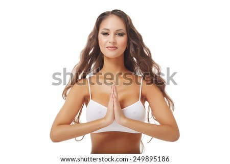 Image of woman with hands in Namaste prayer mudra  - stock photo