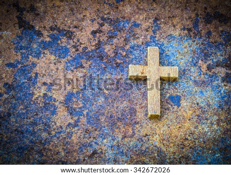 Image of wooden cross on rusty metal, old zinc background - stock photo