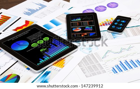 Image of working place with mobile phone and tablet PC - stock photo