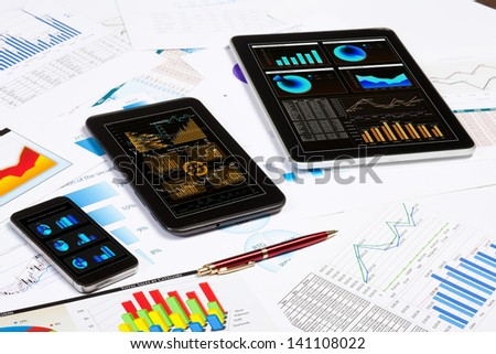 Image of working place with mobile phone, ipad and tablet PC - stock photo