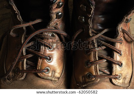 Image of worn leather boots - stock photo