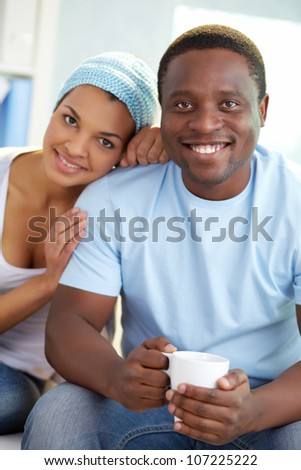 Image of young African couple looking at camera with smiles - stock photo