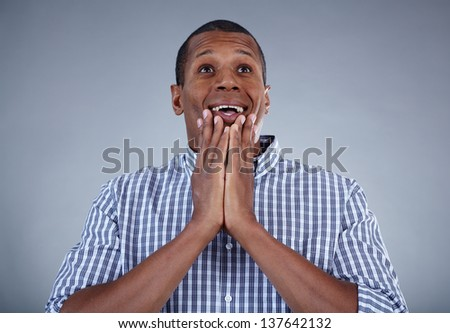 Image of young African man in surprise - stock photo