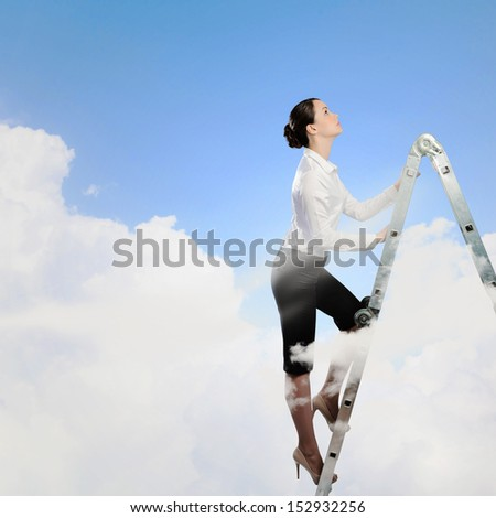 Image of young ambitious businesswoman climbing ladder. Promotion concept - stock photo