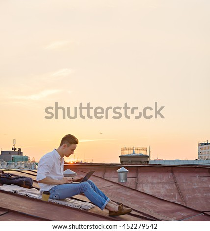 image of young attractive man with laptop