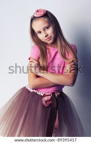 Image of young ballerina posing, isolated on white