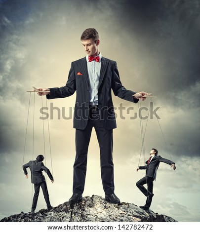 Image of young businessman puppeteer. Leadership concept