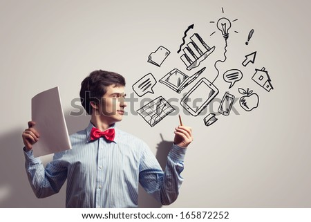 Image of young businessman with notebook drawing collage - stock photo