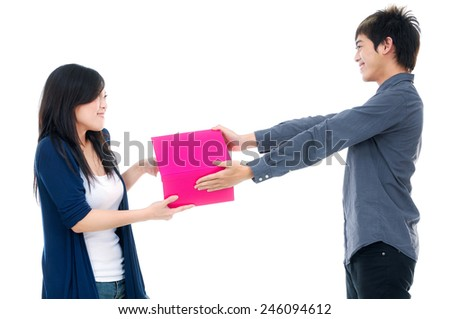 Image of young couple with gift box - stock photo