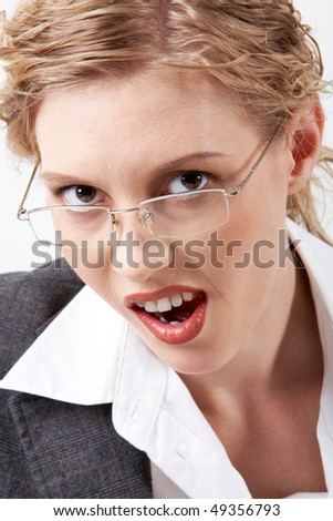Image of young disgusted woman looking at camera through eyeglasses