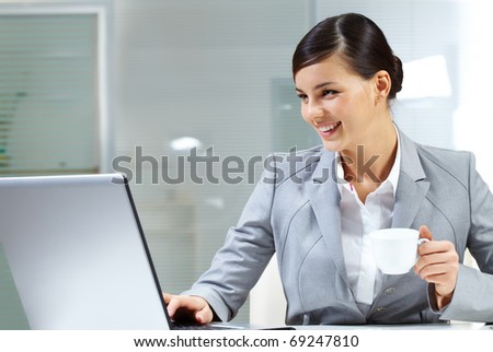 Image of young employer doing computer work in office - stock photo