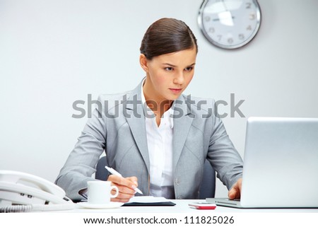 Image of young employer planning work in office - stock photo