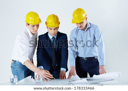 Image of young engineers working with the business project at the workplace  - stock photo