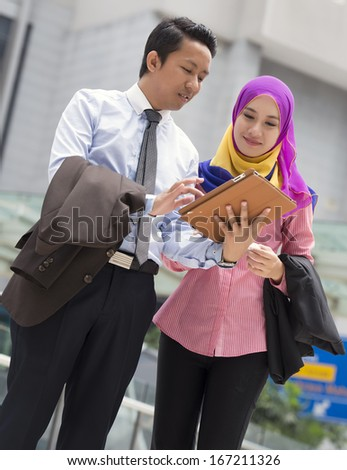 Image of young executive having some discussion - stock photo