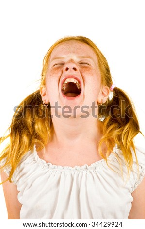 Image of young girl screaming on a white background - stock photo