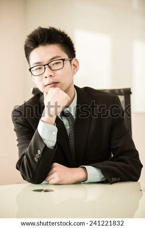 Image of young handsome confident businessman in suit.Asian - stock photo