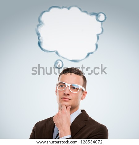 Image of young man thinking of his plans. Lots of copyspace inside graphic cloud for your text - stock photo