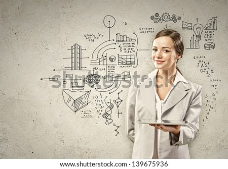 Image of young woman holding in hands tablet - stock photo