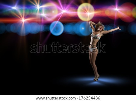image of young woman in bikini and hat dancing, isolated on black background
