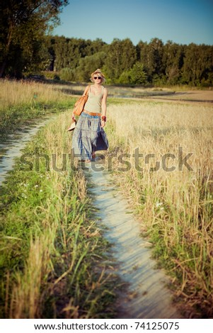 Image of young woman on the road - stock photo