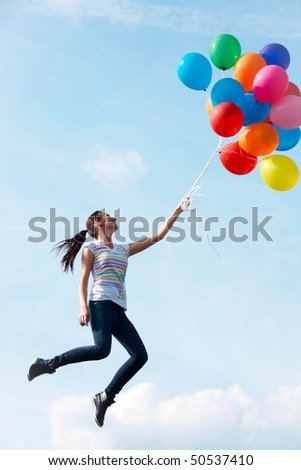 Image of young woman with colorful balloons flying - stock photo
