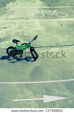 Image regarding to the first steps in life or business when easy choices don't mean the right ones. In this case it represents doubt due to the bicycle in the middle and the two opposite ways. - stock photo