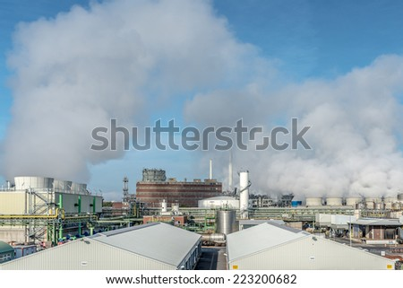 Image showing the man made pollution being pumped into the atmosphere at a processing plant - stock photo