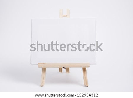 Image shows a white canvas on easel - stock photo