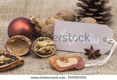 Image shows christmas decoration with merry xmas tag