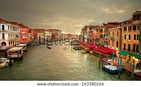 Image taken from the Rialto bridge over the  Grand Canal at sunset in Venice - Italy