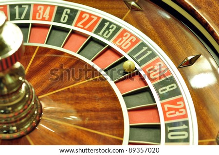 image with a casino roulette wheel with the ball on number 11
