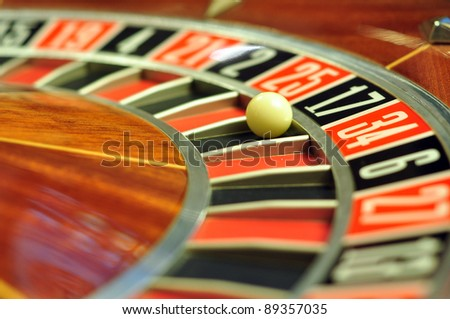 image with a casino roulette wheel with the ball on number 17 - stock photo