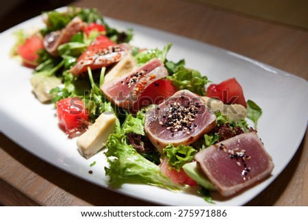 Image with a plate of vegetables and meat - stock photo