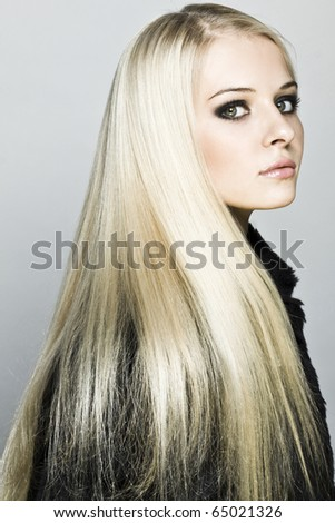 Image with beautiful blonde girl on grey background close-up - stock photo