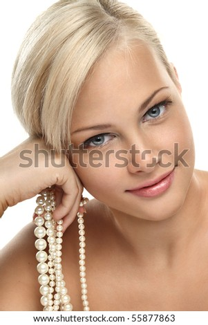 Image with beautiful blonde smiling girl with Pearl beads on white background close-up jew-ellery - stock photo