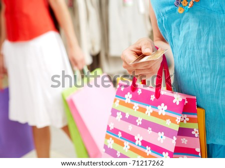 Image with focus on woman?s hand giving plastic card in the mall - stock photo