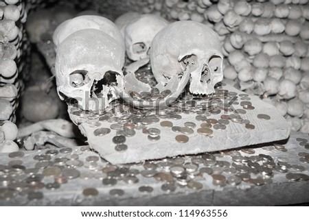 Image with skuls and money in Kutna Hora - Czech Republic - stock photo
