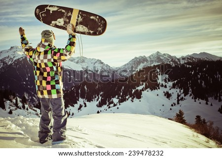 image with snowboarder with a hat on the background of high snowy mountain Alps in Grindelwald, Swiss - stock photo