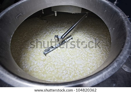 Images from an italian cheese factory producing mozzarella, provola, provolone, ricotta. - stock photo