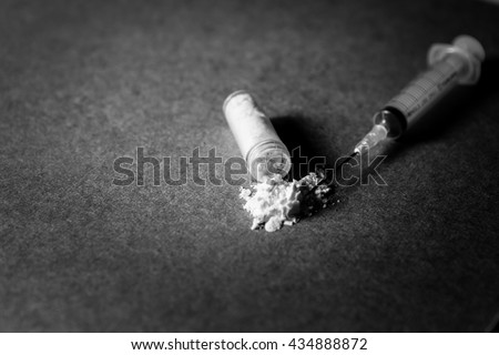Images of drug needles and drug. The picture is staged and there is no real drugs. (Black and white Image) - stock photo