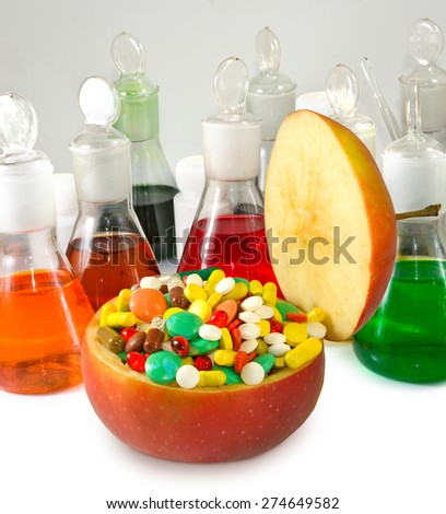 Images of tablets in the apple and chemical ware - stock photo
