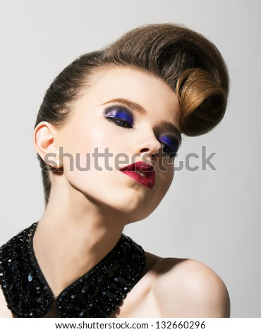 Imagination. Bright Young Woman with Blue Holiday Eye Makeup and Festive Hairstyle - stock photo