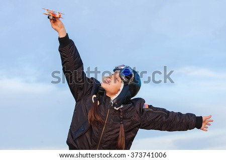 imagination, child playing with plane dreaming about vacation - stock photo